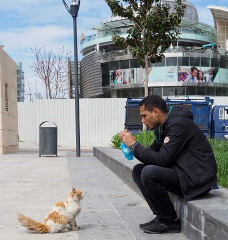 An Egyptian worker at Abdali mall shares his lunch